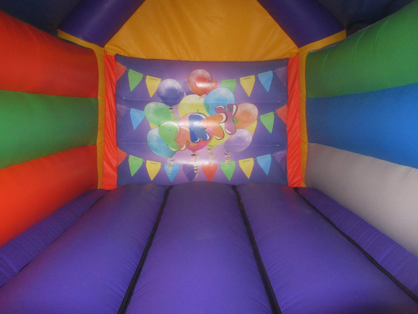 15x11-orange-purple-party-bouncy-castle-bw-compressor